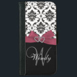 """Personalized Initial, Pink, Black Damask Pattern Wallet Phone Case For iPhone 6/6s<br><div class=""""desc"""">This monogrammed black and white damask pattern has a photo of this design embedded into the hard plastic cover. The design is made up of a black and white damask pattern, a printed pink bow and ribbon, two hearts with diamonds and a black bottom portion where you can add your...</div>"""