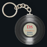 "personalized music vinyl record keychain<br><div class=""desc"">The image of a vinyl-record with custom name and initial,  with the words &#39;let the music play&#39;</div>"