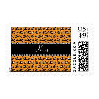 Personalized name bright orange skulls pattern postage stamps