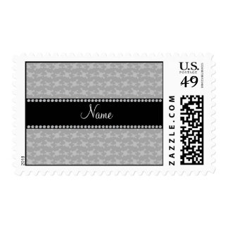 Personalized name gray skulls pattern postage