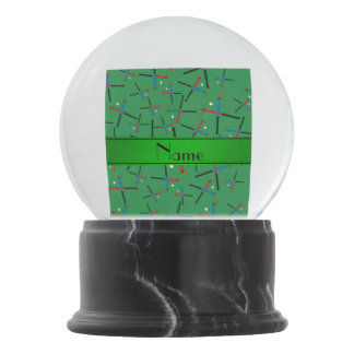 Personalized name green field hockey pattern snow globe