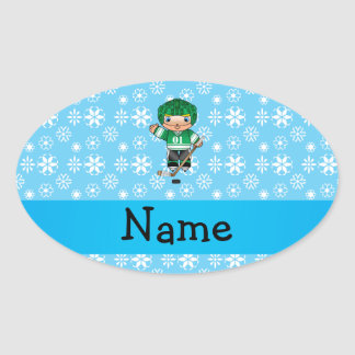 Personalized name hockey player blue snowflakes oval sticker