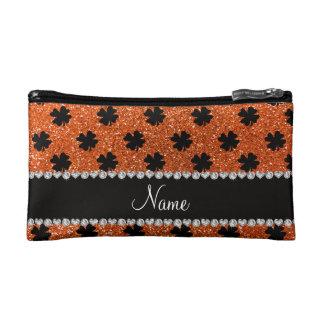 Personalized name orange glitter shamrocks makeup bags