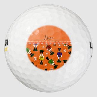 Personalized name orange nutcrackers golf balls