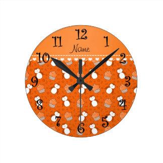 Personalized name orange penguins cupcakes stars round clock