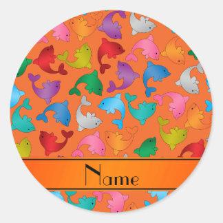 Personalized name orange rainbow dolphins classic round sticker