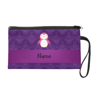 Personalized name pink penguin purple damask wristlet clutch