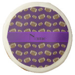 Personalized name purple footballs sugar cookie