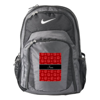 Personalized name red dog paw prints backpack