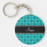 Personalized name turquoise dog paw prints key chains