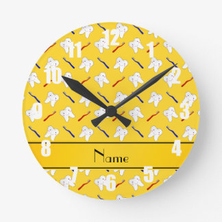 Personalized name yellow brushes and tooth pattern round clocks
