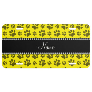 Personalized name yellow dog paw print license plate