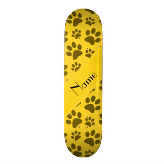 Personalized name yellow dog paws skateboard deck