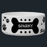 "Personalized paw prints and dog bone pet food bowl<br><div class=""desc"">This ceramic dog food bowl has lots of little black paw prints and polka dots everywhere.  In the middle,  there is a large black bone with an easily customized name of your doggie.</div>"
