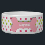 "Personalized pink polkadots dog bone pet food bowl<br><div class=""desc"">This ceramic dog food bowl has a pink,  fuchsia,  and green polka dot pattern in the background.  In the middle,  there is a large pink bone with an easily customized name of your doggie written in white.</div>"