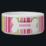 "Personalized pink stripes dog bone pet food bowl<br><div class=""desc"">This ceramic dog food bowl has a pink,  fuchsia,  green and white stripes pattern in the background.  In the middle,  there is a large white bone with an easily customized name of your doggie written in hot pink.</div>"