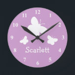 """Personalized pink wall clock with butterflies<br><div class=""""desc"""">Personalized pink wall clock with butterflies. Pink / purple lavender and white wall clock with cute butterfly print and custom name for baby room. Cute gift idea for girl&#39;s baby room. Baby pink nursery decoration with personalizable name. Insect animal print.</div>"""
