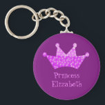 "Personalized Princess pink and purple tiara Keychain<br><div class=""desc"">A pink and purple princess crown against a purple background with shining stars. Personalize with the girls name.</div>"