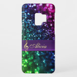 "Personalized Rainbow Glitter Music Galaxy S9 Case<br><div class=""desc"">Personalized Rainbow Glitter Music Clef Galaxy S9 Case. Color glitter effect print with cool hued tones of blues,  green and purple,  with a metallic gold looking musical treble clef on a royal purple belt..  Fill in your name at the prompt to personalize and customize anyway you like.</div>"