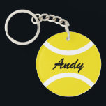 "Personalized tennis ball keychain with name<br><div class=""desc"">Personalized yellow tennis ball keychain with name.  Custom round key chain for friends,  family,  kids,  coach,  trainer,  player,  fan etc. Create your own sports Birthday party favor gifts for adults and children. Also nice for club or event.</div>"