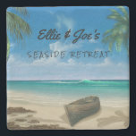 """Personalized Tropical Scene Stone Coaster<br><div class=""""desc"""">Personalized stone drink coaster. Add first names, family name, business name, or any text to the first line of text which is bold, black script. Beneath is another line to customize in fun printed font style. Blue ocean water, and blue sky is the background with an old boat on the...</div>"""