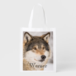 Personalized wolf face in a winter forest grocery bag