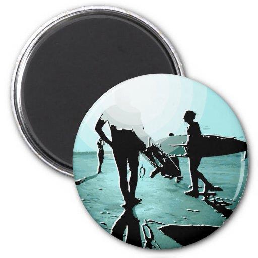 personas que practica surf iman