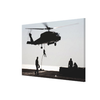 Personnel fast-rope out of an SH-60F Canvas Print