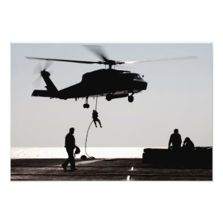Personnel fast-rope out of an SH-60F Photograph