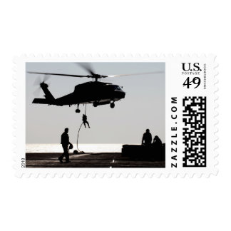 Personnel fast-rope out of an SH-60F Postage Stamp