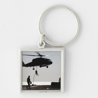 Personnel fast-rope out of an SH-60F Silver-Colored Square Keychain