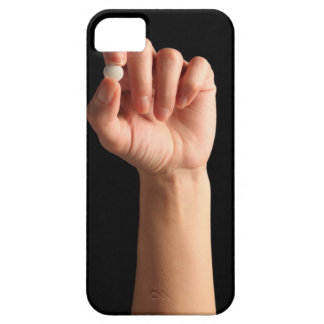 Persons hand holding a white pill between the iPhone SE/5/5s case