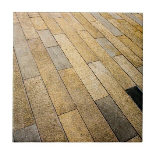 Perspectiva de las piedras de pavimentación azulejo cuadrado pequeño