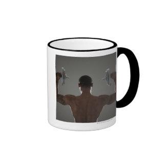Pesas de gimnasia de elevación físicamente cabidas taza de café