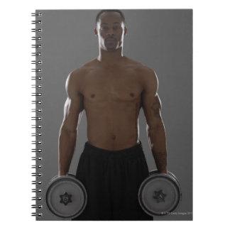 Pesas de gimnasia de elevación físicamente cabidas cuadernos