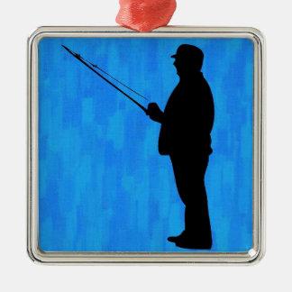 Pesca del hombre con el fondo azul abstracto adorno navideño cuadrado de metal