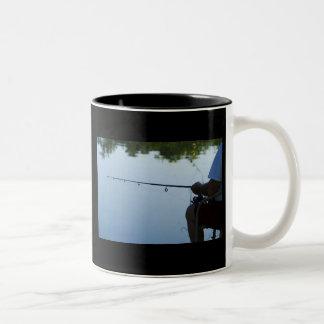 Pesca del hombre taza