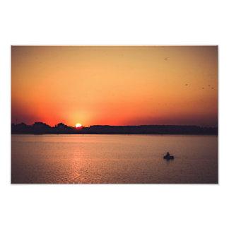 Pescadores en la puesta del sol fotografía