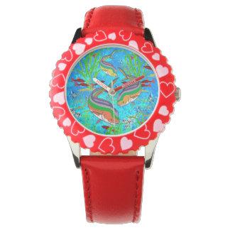 Pescados coloridos subacuáticos - reloj del