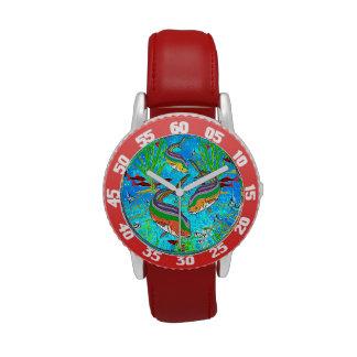 Pescados coloridos subacuáticos - reloj del ejempl