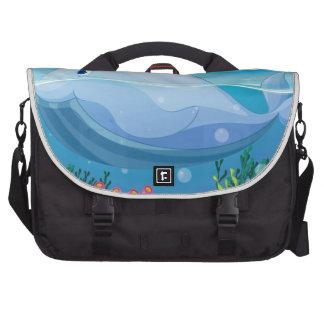 pescados, isla y coral en el mar bolsas de portatil