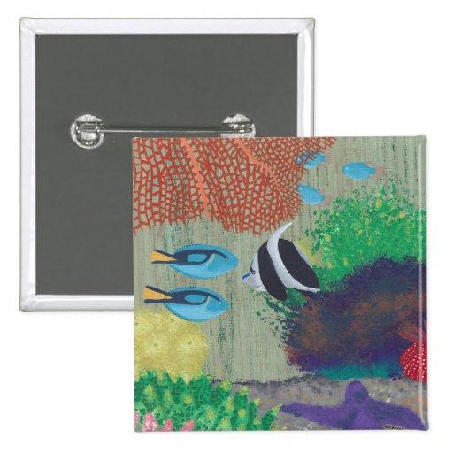 Pescados tropicales coloridos que pintan el Pin en