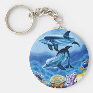 Pescados tropicales de los delfínes llavero redondo tipo pin