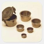 Pesos usados por los comerciantes y los boticarios pegatina cuadrada