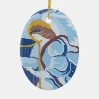 Pesque con caña en azul con la arpa, ornamento del adorno navideño ovalado de cerámica