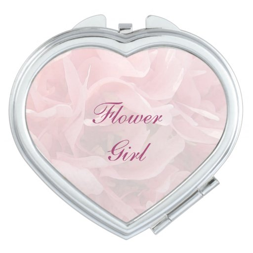 Pétalos de la amapola que casan al florista espejos de maquillaje