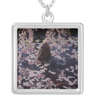 Petals floating on fish pond silver plated necklace