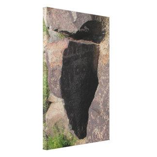 Petroglifo espiritual de la entidad lienzo envuelto para galerías