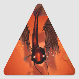 Pez volador divertido pegatina triangular