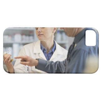 Pharmacist helping customer with medicine iPhone 5 cases